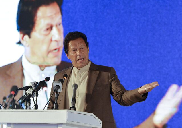 Pakistan's Prime Minister Imran Khan delivers a speech during the Refugee Summit Islamabad to mark 40 years of hosting Afghan refugees, in Islamabad on February 17, 2020.