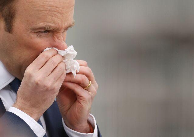 Matt Hancock blows his nose