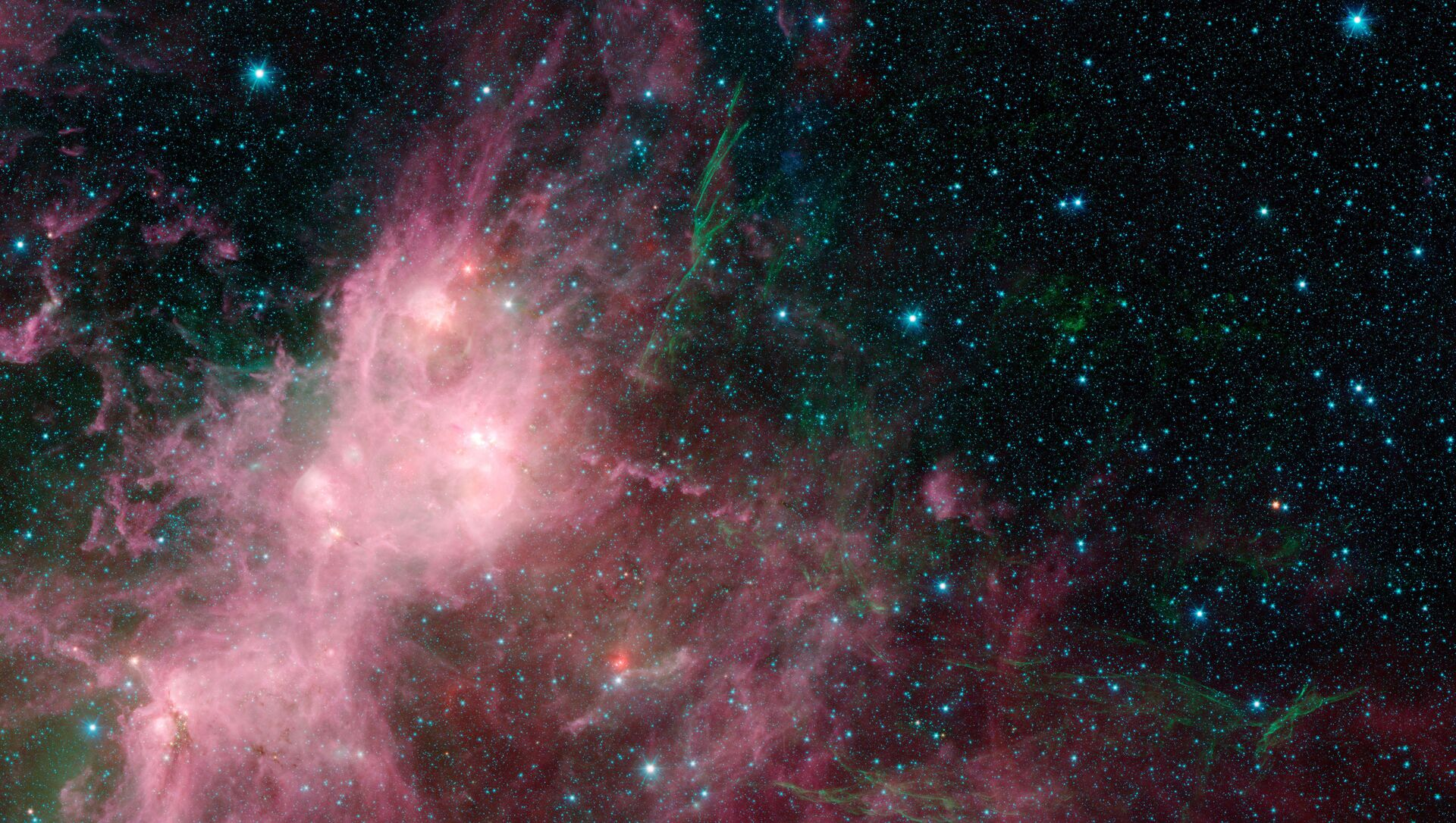 This image made available by NASA shows infrared data from the Spitzer Space Telescope and Wide-field Infrared Survey Explorer (WISE) in an area known as the W3 and W5 star-forming regions within the Milky Way Galaxy - Sputnik International, 1920, 24.02.2021