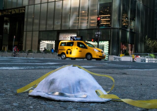 A face mask used to protect from the coronavirus disease (COVID-19) is seen on the ground near Trump Tower in New York City, New York, U.S., March 14, 2020