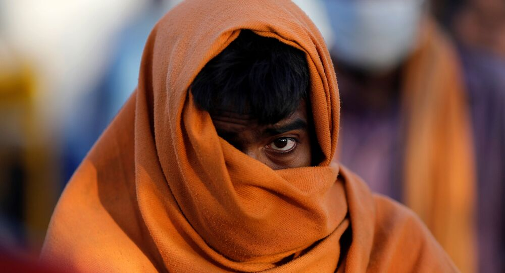 A homeless man stands in a queue as he waits for food during a 21-day nationwide lockdown to slow the spreading of the coronavirus disease (COVID-19) in New Delhi, India, April 3, 2020