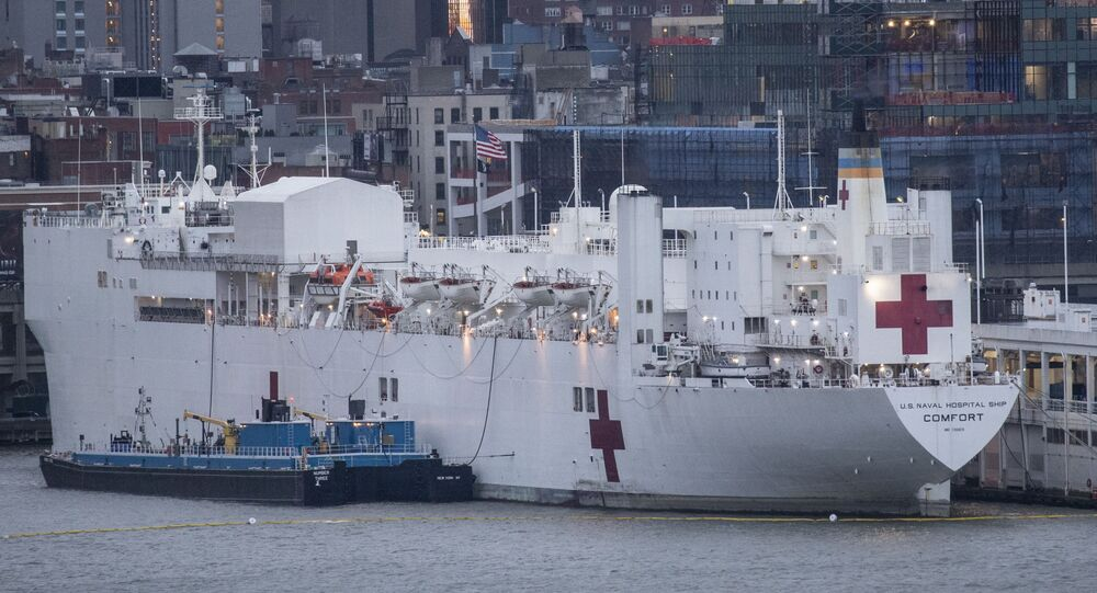 The USNS Comfort navy hospital ship is docked at Pier 90 in Manhattan on April 3, 2020 as seen from West New York, New Jersey.