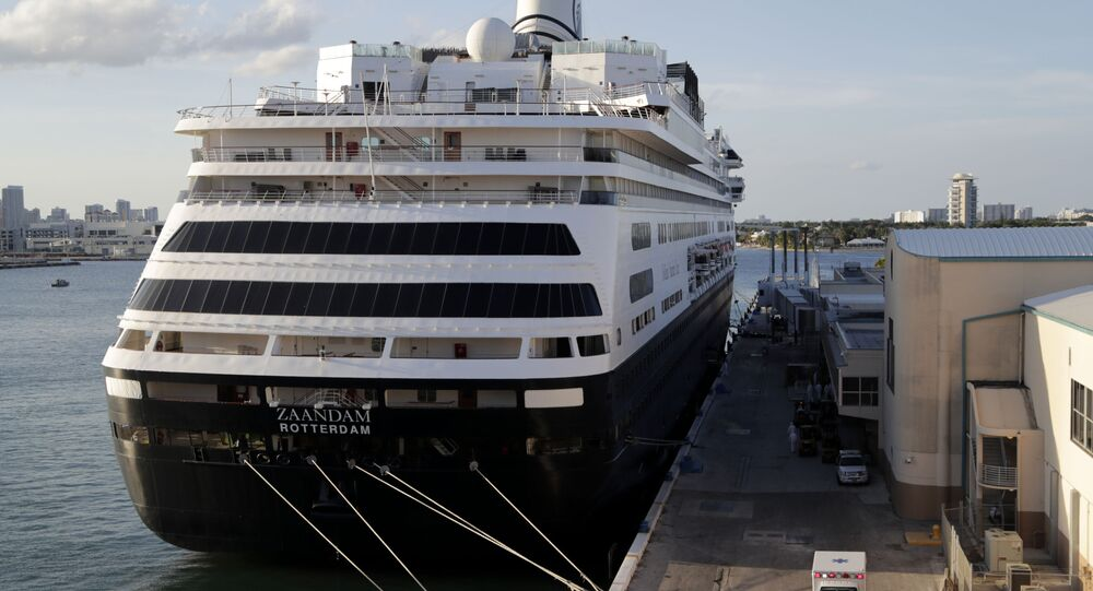 An ambulance leaves as Carnival's Holland America cruise ship Zaandam is docked at Port Everglades during the coronavirus pandemic, Thursday, April 2, 2020, in Fort Lauderdale, Fla.