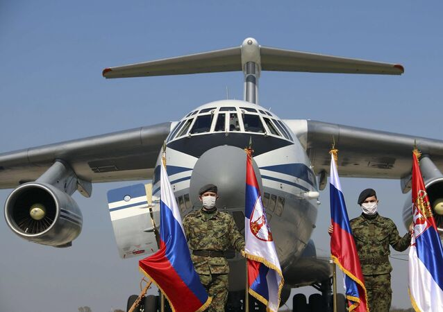 Russian military transport plane with medical supplies on the tarmac at Batajnica military airport near Belgrade