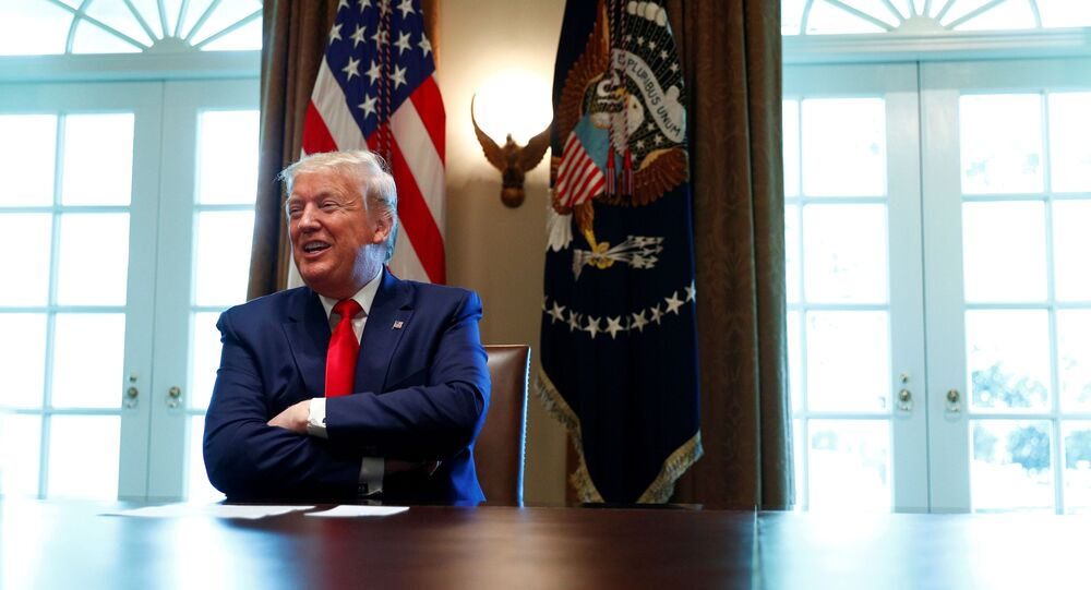 U.S. President Donald Trump laughs during a roundtable meeting with energy sector CEOs in the Cabinet Room of the White House in Washington, U.S., April 3, 2020
