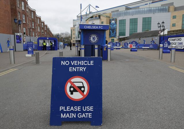 A sign at Chelsea's Stamford Bridge stadium, as the English Premier League is suspended until April 3, in London, Friday, March 13, 2020.