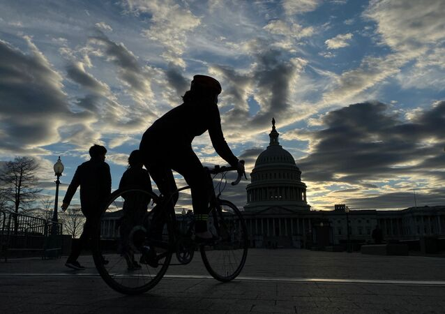 Walkers and cyclists take to the east front of the U.S. Capitol during the outbreak of the coronavirus disease (COVID-19), as personal exercise is exempted from the city-wide stay at home orders, in Washington, U.S. April 3, 2020.