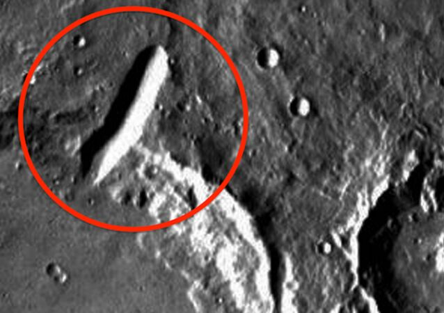 A screenshot of a satellite image of the Mars surface with what ET Data Base's Scott E. Waring called a building sitting on the edge of a crater (encircled in red).