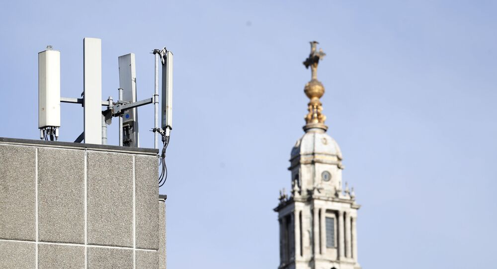 Mobile network phone masts are visible in front of St Paul's Cathedral in the City of London, Tuesday, Jan. 28, 2020.