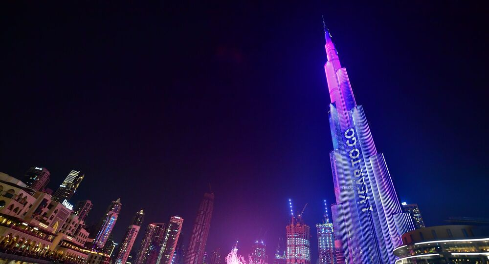 Dubai's Burj Khalifa, the world's tallest building is illuminated during festivities marking the one-year countdown to Expo 2020