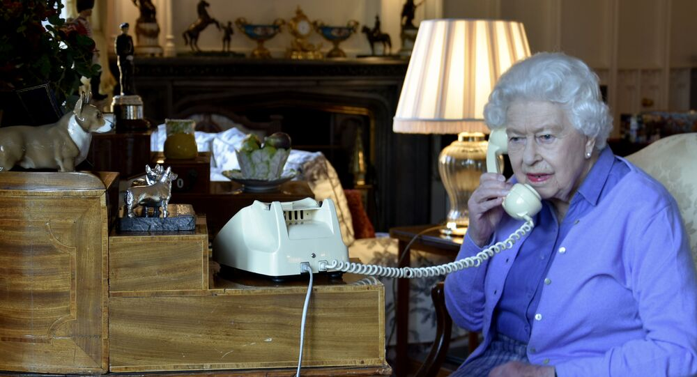 A handout picture released by Buckingham Palace on March 25, 2020 shows Britain's Queen Elizabeth II holding her weekly audience with Britain's Prime Minister Boris Johnson on the phone from Windsor Castle in Windsor, west of London on March 25, 2020. - Prince Charles, the eldest son and heir to Queen Elizabeth II, is showing mild symptoms of the new coronavirus and is self-isolating in Scotland, his office said on March 25. Clarence House said doctors believe Charles became contagious on March 13 -- a day after last meeting his mother. The 93-year-old queen has been staying with her 98-year-old husband Prince Philip at Windsor Castle, 640 miles (820 kilometres) south of Balmoral, since March 19