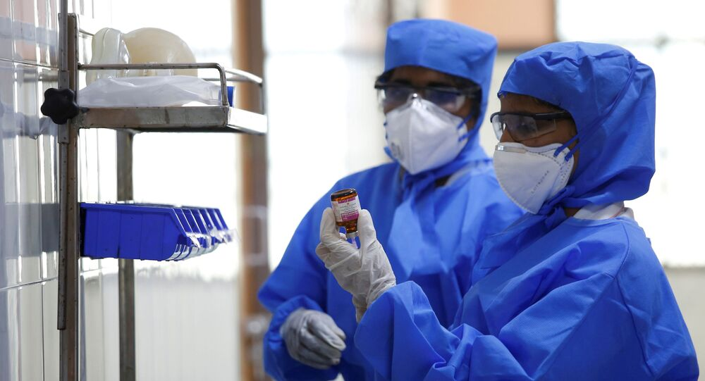 FILE PHOTO: Medical staff with protective clothing are seen inside a ward specialised in receiving any person who may have been infected with coronavirus, at the Rajiv Ghandhi Government General hospital in Chennai, India, January 29, 2020.
