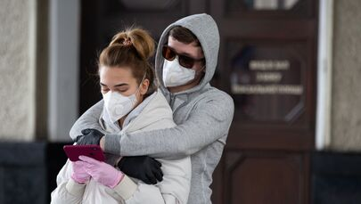 Love in the Time of Coronavirus: Couples Wear Face Masks Over COVID-19 Fears