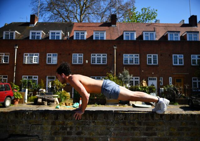 Man exercises outside his home in London, as the spread of the coronavirus disease (COVID-19) continues