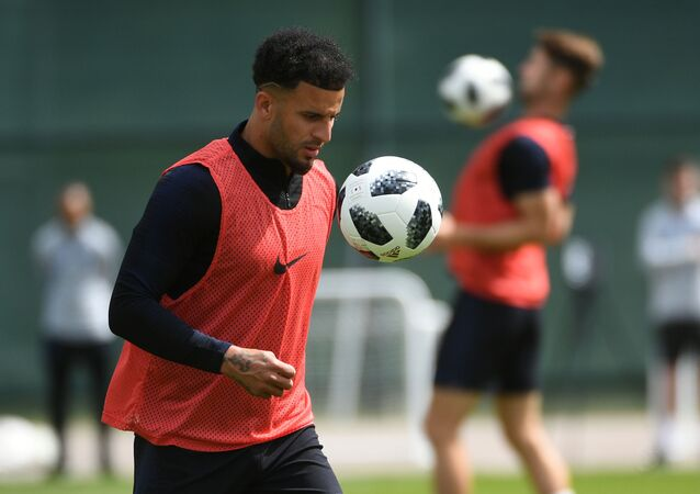 England's Kyle Walker plays with a ball