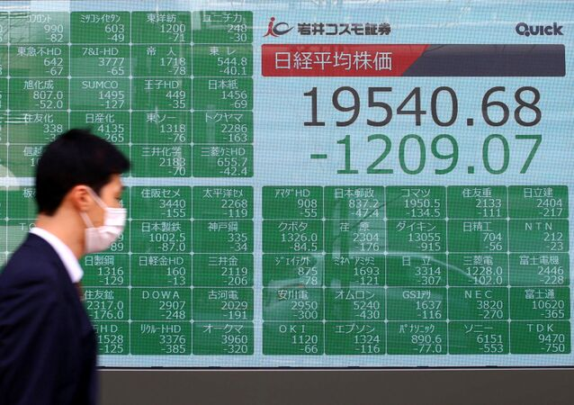 Asian markets indices outside a brokerage in Tokyo