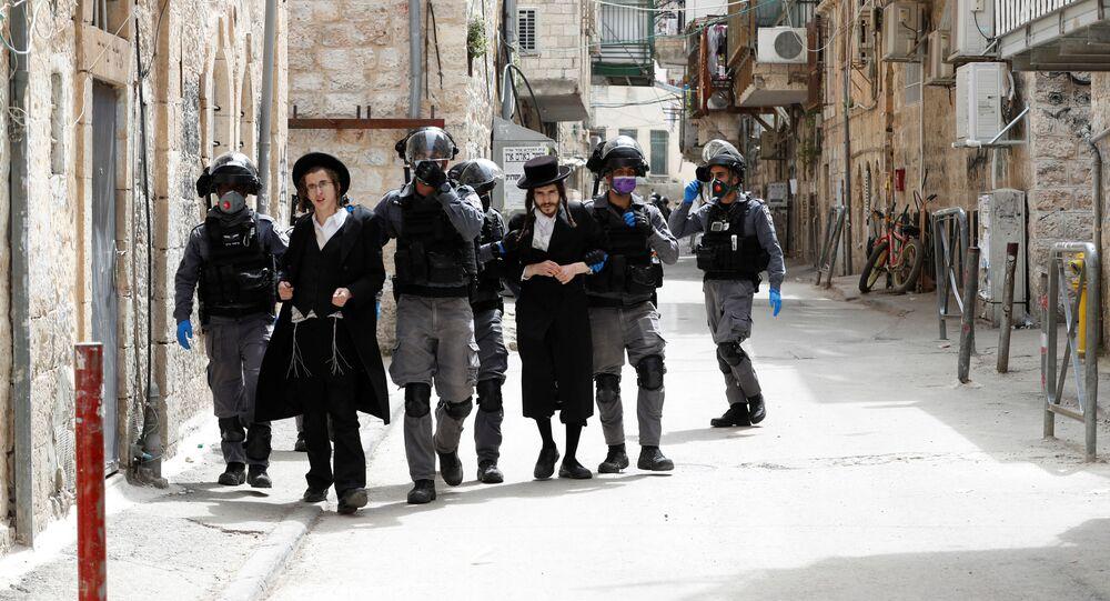Israeli police detain ultra-Orthodox Jewish men during scuffles as police enforce a partial lockdown against the coronavirus disease (COVID-19) in Mea Shearim neighbourhood of Jerusalem March 30, 2020