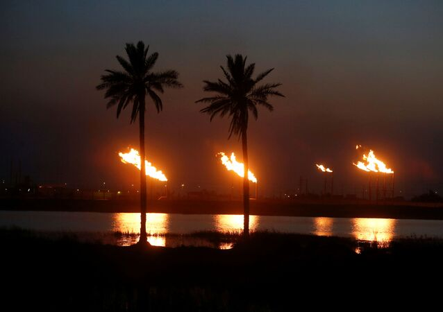 Flames emerge from flare stacks at Nahr Bin Umar oil field, north of Basra, Iraq March 9, 2020
