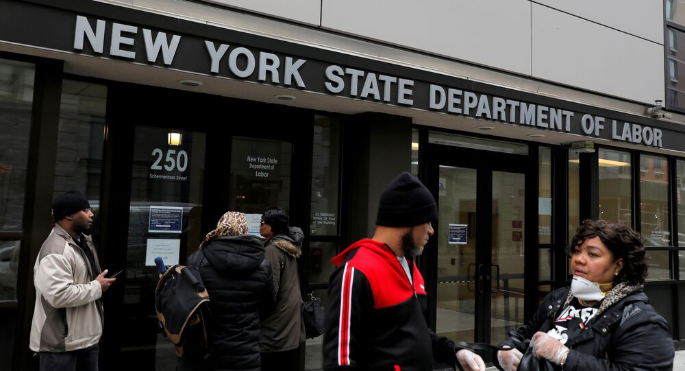 People gather at the entrance for the New York State Department of Labor offices, which closed to the public due to the coronavirus disease (COVID-19) outbreak in the Brooklyn borough of New York City, U.S., March 20, 2020