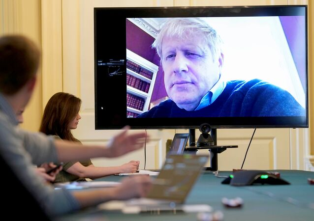 Britain's Prime Minister Boris Johnson appears on a monitor for the coronavirus disease (COVID-19) meeting in London, Britain March 28, 2020