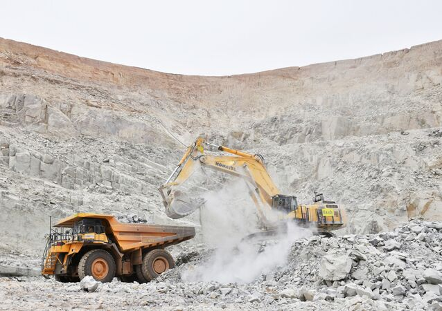An excavator driven by Rosalie Guirou Kulga, 30, clears out rocks into a dumper at the gold mine, operated by Endeavour Mining Corporation in Hounde, Burkina Faso. Picture taken February 11, 2020.