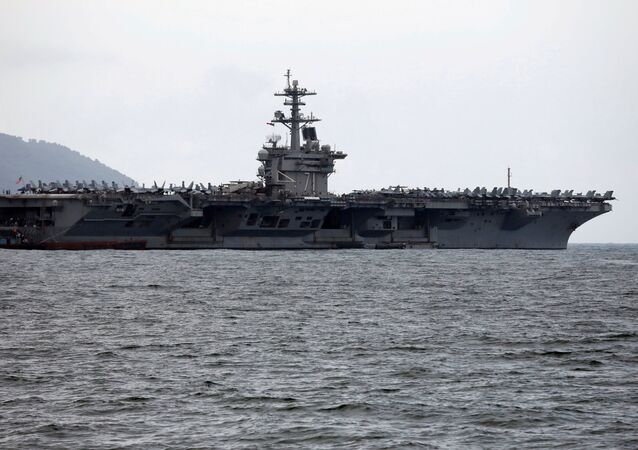 The USS Theodore Roosevelt (CVN-71) is seen while entering into the port in Da Nang, Vietnam, March 5, 2020