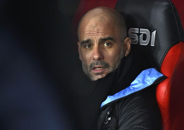 Manchester City's head coach Pep Guardiola looks out from the bench prior the English Premier League soccer match between Sheffield United and Manchester City at Bramall Lane in Sheffield, England, Tuesday, Jan. 21, 2020.