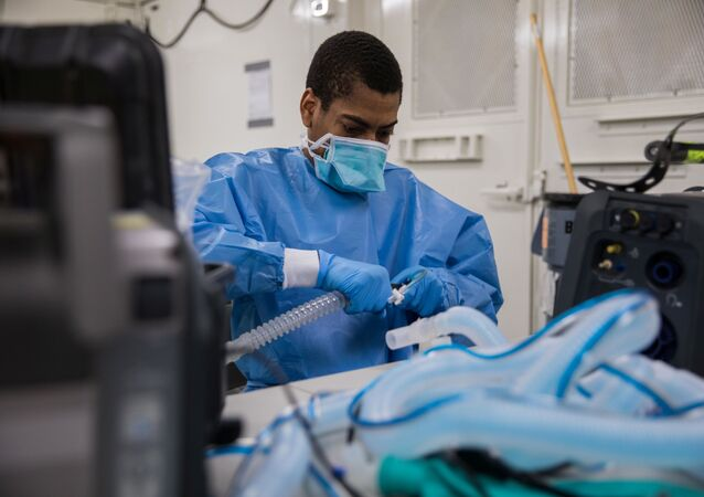 U.S. Army Specialist Fredrick Spencer assembles a T1 Hamilton ventilator in a mobile lab unit in the Javits New York Medical Station intensive care unit bay monitoring coronavirus disease (COVID-19) patients in New York City, U.S. Apri 4, 2020