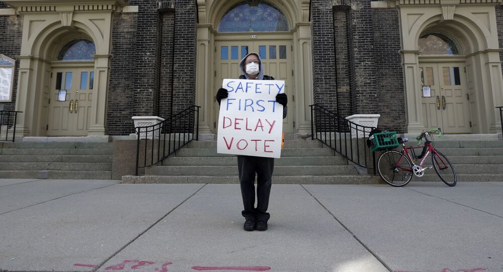 Jim Carpenter protests Tuesday's scheduled election amid the coronavirus pandemic Monday April 6, 2020, in downtown Milwaukee
