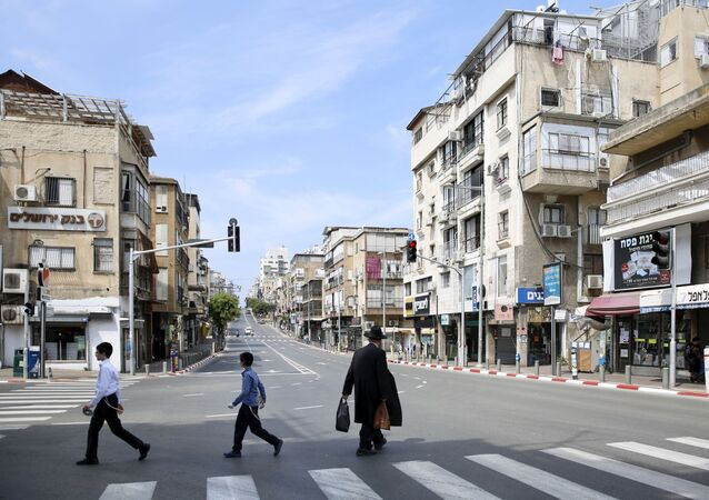 An Ultra orthodox man crosses a street in the city of Bnei Brak, a Tel Aviv suburb, Israel, Thursday, April 2, 2020. On Wednesday, Netanyahu ordered a police cordon around the largely ultra-Orthodox city of Bnei Brak, east of Tel Aviv, to limit movement to and from the city. Bnei Brak has the second highest number of coronavirus cases in Israel.