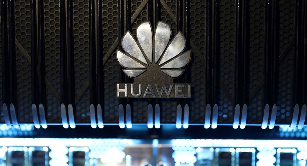 A logo is pictured on a Huawei NetEngine 8000 Intelligent Metro Router during a 5G event in London, on February 20, 2020
