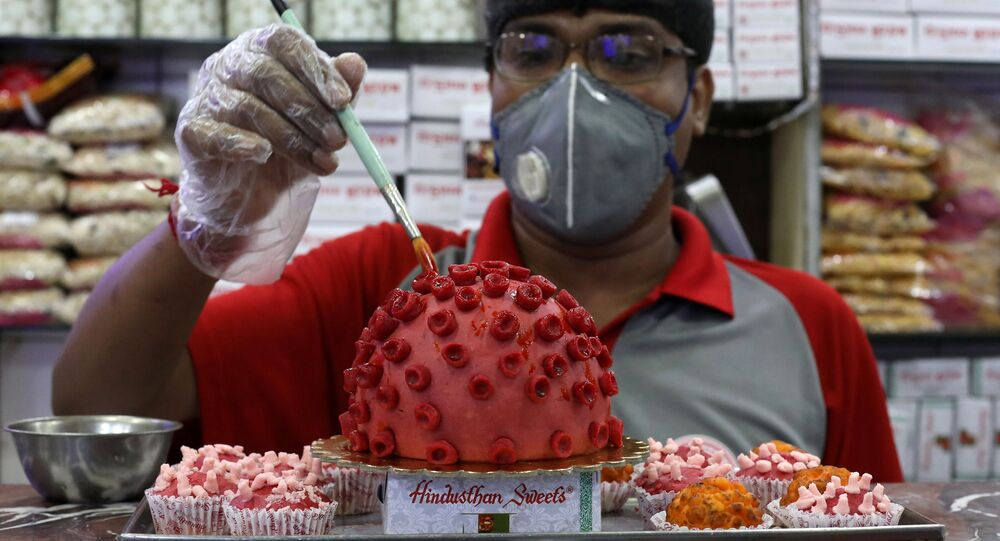 A confectioner applies finishing touches to a replica of coronavirus made out of sweets at a confectionary workshop during a 21-day nationwide lockdown to slow the spreading of coronavirus disease (COVID-19) in Kolkata, India, April 6, 2020