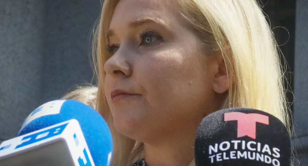 In this 27 August 2019, photo, Virginia Roberts Giuffre, who says she was trafficked by sex offender Jeffrey Epstein, holds a news conference outside a Manhattan court where sexual assault claimants invited by a judge addressed a hearing in the wake of Epstein's jailhouse death in New York.
