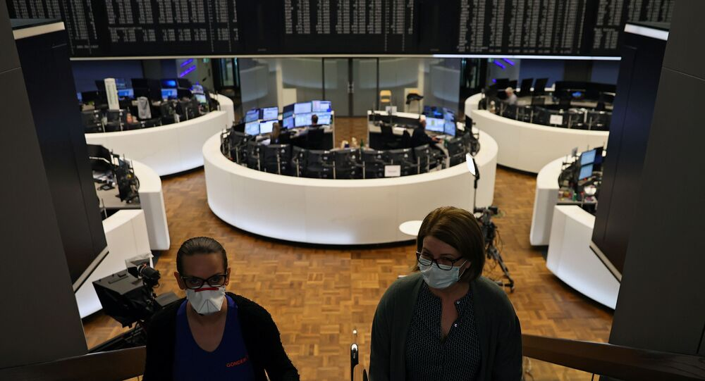 Women wear face masks at Frankfurt's stock exchange as markets react on the coronavirus disease (COVID-19), at the stock exchange in Frankfurt, Germany, 27 March 2020.
