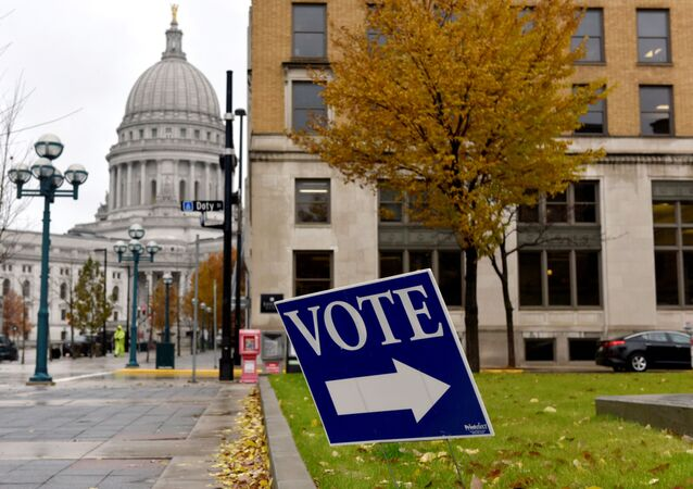 A sign directs voters towards a polling place near the state capitol in Madison, Wisconsin, U.S. November 6, 2018