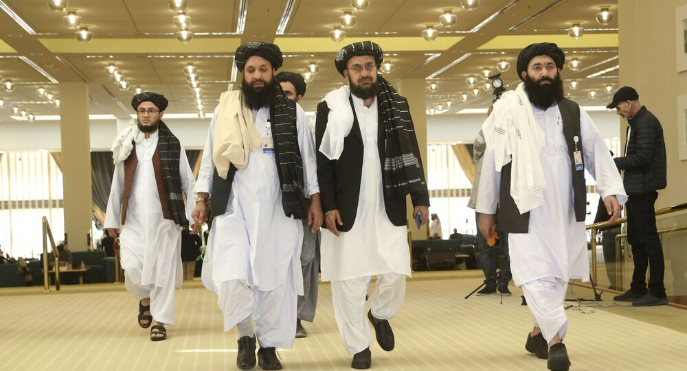 Afghanistan's Taliban delegation arrives for the agreement signing between Taliban and U.S. officials in Doha, Qatar, Saturday, Feb. 29, 2020.