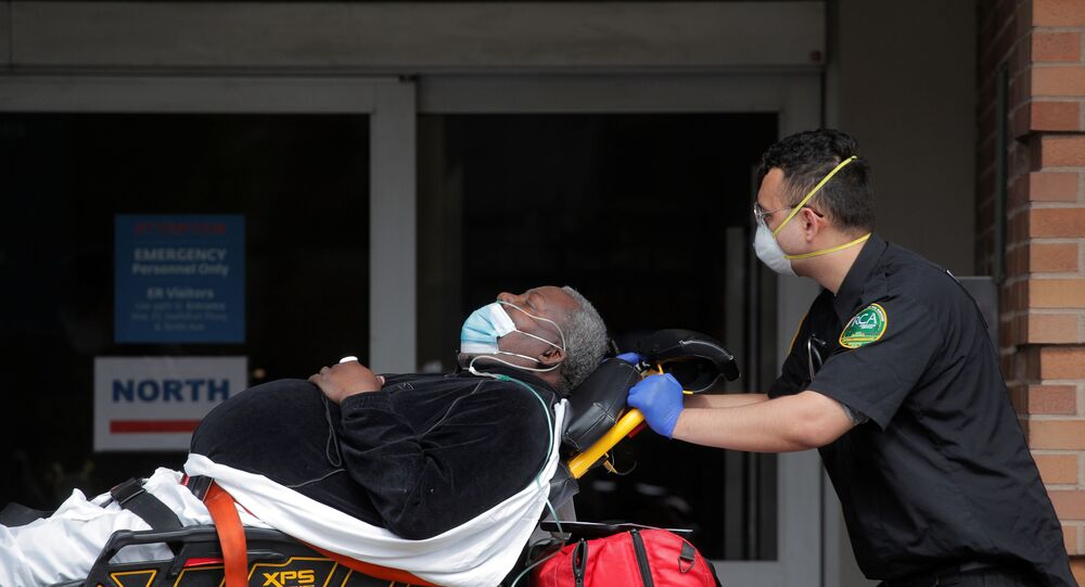 Paramedics take a patient into emergency center at Maimonides Medical Center during outbreak of coronavirus disease (COVID-19) in Brooklyn New York