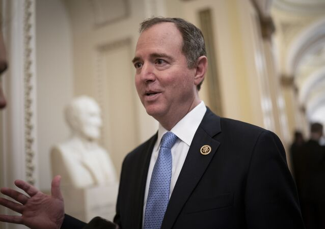 House Intelligence Committee Chairman Adam Schiff, D-Calif., talks to reporters as lawmakers work to extend government surveillance powers that are expiring soon, on Capitol Hill in Washington, Tuesday, March 3, 2020.