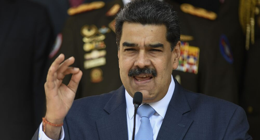 Venezuelan President Nicolas Maduro gives a press conference at the Miraflores Presidential Palace in Caracas, Venezuela, Thursday, March 12, 2020.