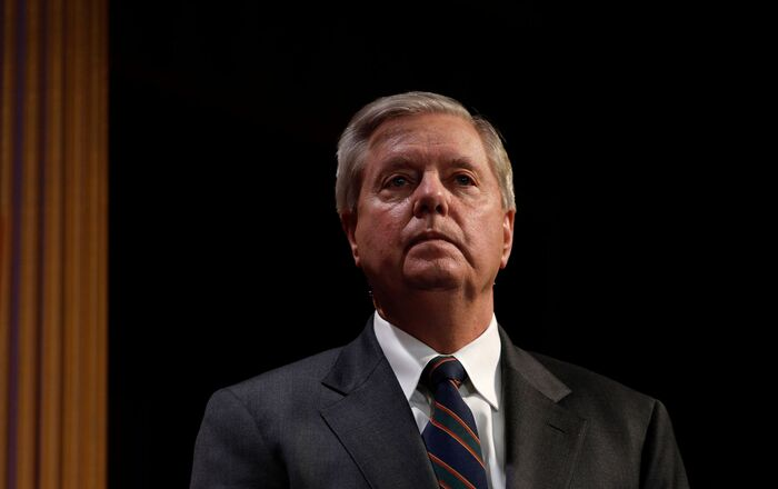 Senator Lindsey Graham (R-SC) looks on as fellow Senators take turns speaking at the podium during a news conference on the coronavirus relief bill, on Capitol Hill in Washington, U.S., March 25, 2020.