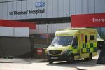 An ambulance leaves St Thomas' Hospital in central London on April 7, 2020, where Britain's Prime Minister Boris Johnson is in intensive care with symptoms of the novel coronavirus COVID-19