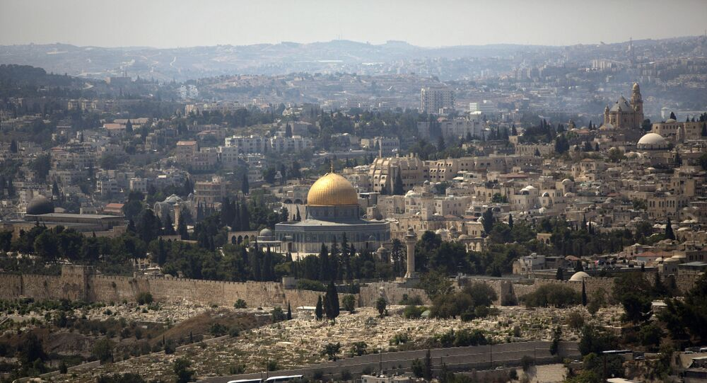 In this Monday, Sept. 9, 2013 file photo, the Dome of the Rock Mosque in the Al Aqsa Mosque compound, known by the Jews as the Temple Mount, is seen in Jerusalem's Old City. 2014 was supposed to be a record-breaking year for tourist visits to Israel. But all that changed when this summer's 50-day war between Israel and Hamas prompted jittery travelers to cancel trips en masse. Merchants in Jerusalem's Old City say the feel the sting. The area's cobblestone streets are typically chock full of tourists visiting the holy sites within the storied walls. But they've been eerily empty over the summer.