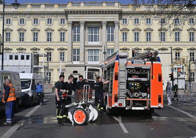 A fire truck is seen near the passageway on the ground floor of the new building of the Berlin City Palace after a fire broke out at the construction site in Berlin on April 8, 2020
