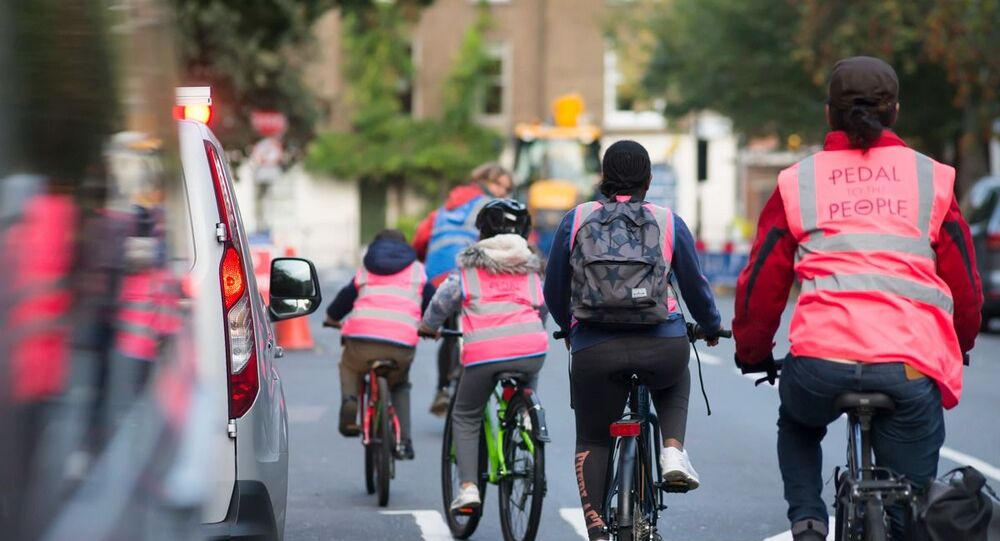 Cycling instructor teaching students in Camden, north London