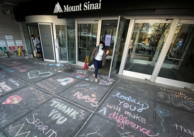 A woman exits Mount Sinai Hospital in Manhattan past messages of thanks written on the sidewalk during the outbreak of the coronavirus disease (COVID19) in New York City, New York, U.S., April 7, 2020.