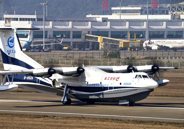 In this Dec. 24, 2017, photo released by Xinhua News Agency, China's AG600, the world's largest amphibious aircraft, also known as Kunlong performs its maiden flight in Zhuhai, south China's Guangdong Province. A Chinese media report says the newly developed sea plane that could expand the military's room to operate in the South China Sea has passed a series of on-water tests.