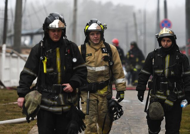Emergency service workers near the gas equipment storage in 2019
