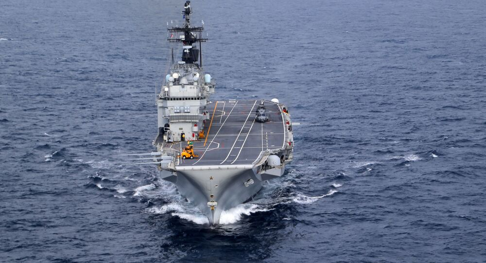 In this Friday, Nov. 25, 2016 photo, the Italian Navy Giuseppe Garibaldi light aircraft carrier, seen from a helicopter, sails on the Mediterranean Sea, off the coast of Sicily, part of the European Union's naval force Operation Sophia. Operation Sophia was launched to disrupt human smuggling operations in the Central Mediterranean.