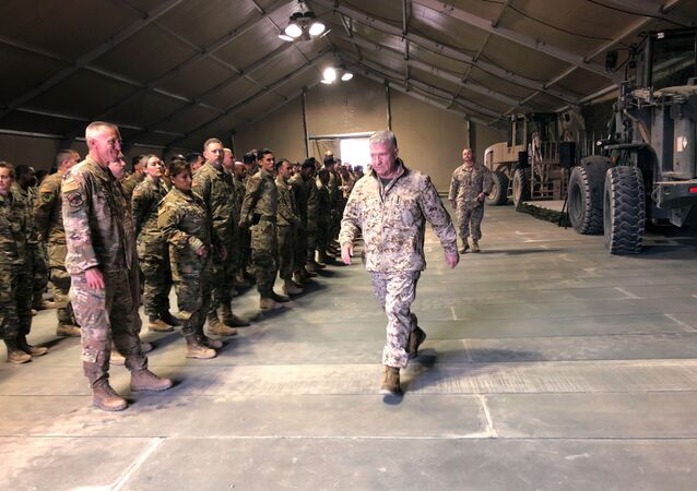 Marine Gen. Frank McKenzie, the top U.S. commander for the Middle East, meets with troops at Prince Sultan Air Base in Saudi Arabia, Wednesday, Jan. 29, 2019