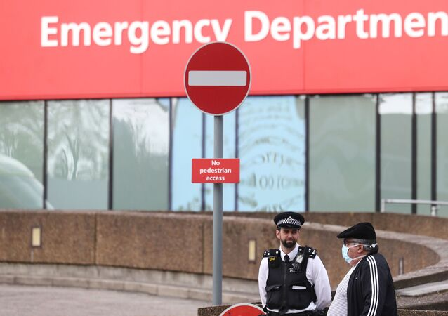 Police officers are seen outside St Thomas' Hospital after British Prime Minister Boris Johnson spent a second night in intensive care after his coronavirus (COVID-19) symptoms worsened on Monday. London, Britain, 8 April 2020.